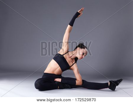 Portrait of sport girl doing stretching exercise