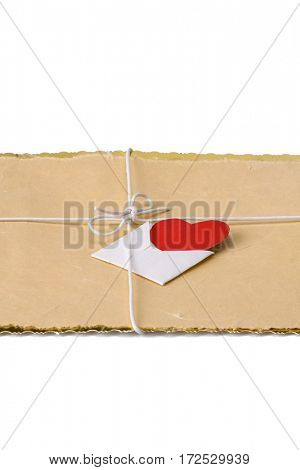String bow with valentine card on brown packing paper