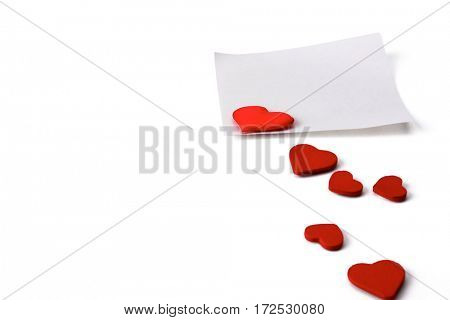 Gift card with valentines heart shaped over white table background