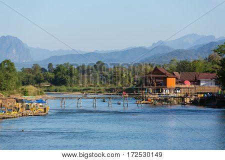 Wooden bridge across Nam Song river at Vang Vieng, Laos