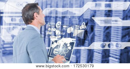 Businessman using laptop against view of data technology 3d