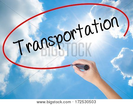 Woman Hand Writing Transportation With Black Marker On Visual Screen.