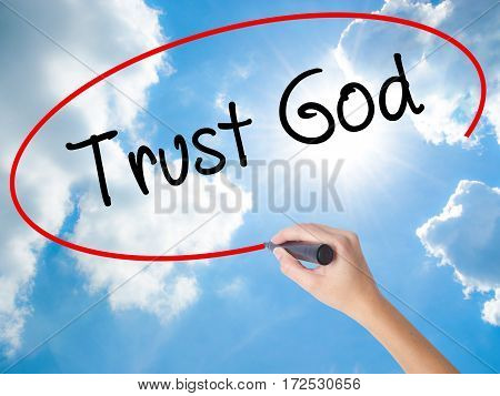 Woman Hand Writing Trust God  With Black Marker On Visual Screen
