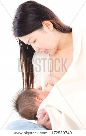 Asian woman breastfeeding her baby on white background