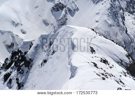 Snow Cornice In High Winter Mountains In Nice Sun Day