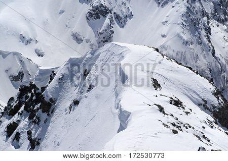 Snow Cornice In High Winter Mountains In Nice Sun Day