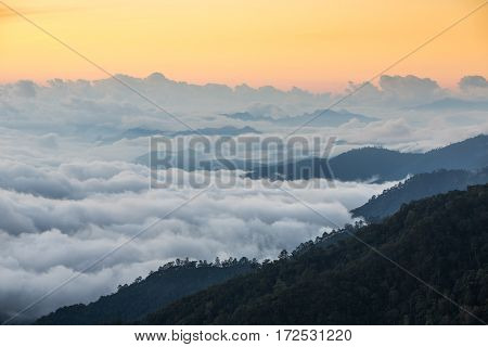 Beautiful landscape with mountains covered in mist during sunrise in Northern Thailand.