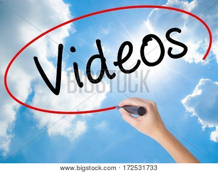 Woman Hand Writing Videos With Black Marker On Visual Screen