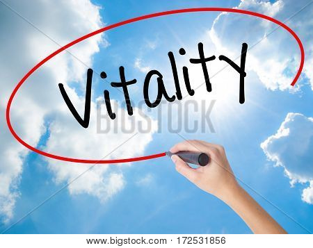 Woman Hand Writing Vitality  With Black Marker On Visual Screen.