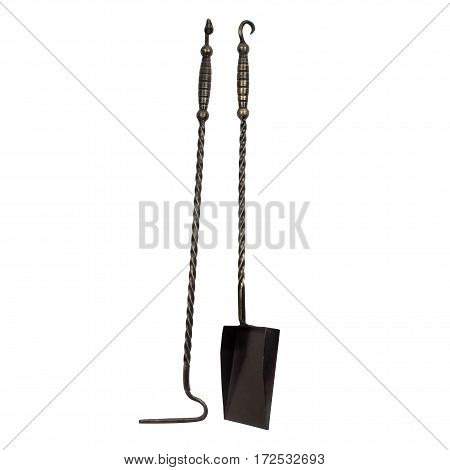 Forged metal poker and shovel for the fireplace isolated on white background