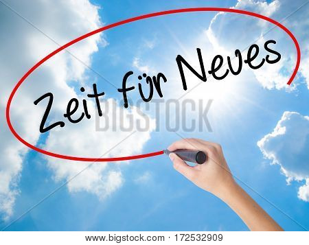 Woman Hand Writing Zeit Fur Neues (time For Something New In German) With Black Marker On Visual Scr