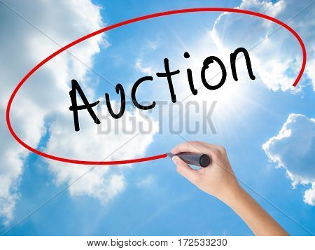 Woman Hand Writing Auction With Black Marker On Visual Screen