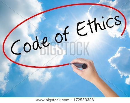 Woman Hand Writing Code Of Ethics With Black Marker On Visual Screen