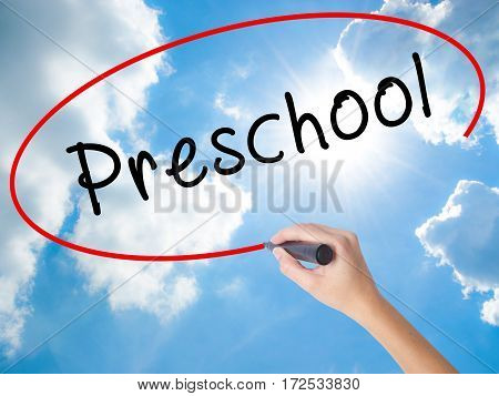 Woman Hand Writing Preschool With Black Marker On Visual Screen