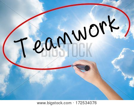Woman Hand Writing Teamwork With Black Marker On Visual Screen