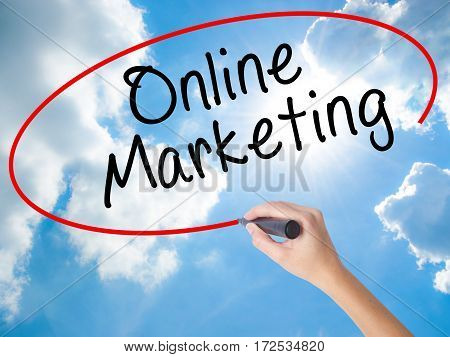 Woman Hand Writing Online Marketing With Black Marker On Visual Screen