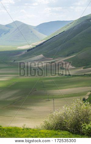 Beautiful view of the old italian mountain village Castelluccio, picturesque Apennine landscape, Norcia, Italy
