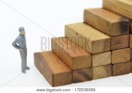 Way to success with mini businessman and wood block step