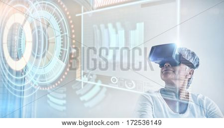 Composite image of volume knob with graphs against senior woman using virtual headset 3d
