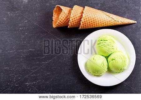 Pistachio Ice Cream Scoops And Waffle Cones