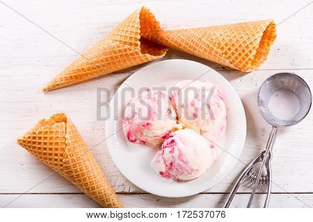 Ice Cream Scoops With Strawberry Syrup