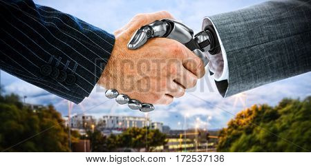 Cropped image of businessman shaking hand of robot against light trails on city street 3d