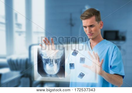Male surgeon touching invisible screen against medical equipment in examining room 3d