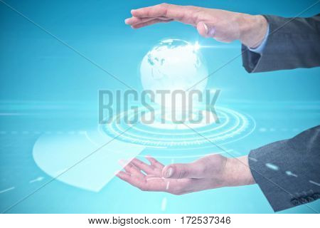 Close-up of business hands gesturing against digitally generated image of earth with illuminated trail