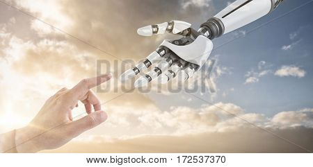 Businessman hand using digital screen against sky