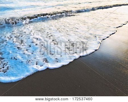 Sea wave over sand beach digital illustration. Oceanic water tide on seashore. Sunset seaside minimal image. Romantic picture for tropical summer exotic travel sea holiday banner. Seaside wedding