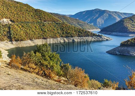 Autumn forest around Meander of Vacha (Antonivanovtsy) Reservoir, Rhodopes Mountain, Bulgaria