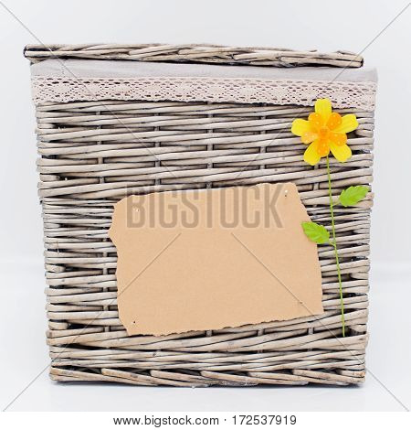 wicker basket with empty blank and flower