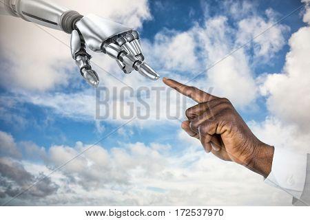 Businessman hand pointing finger against sky