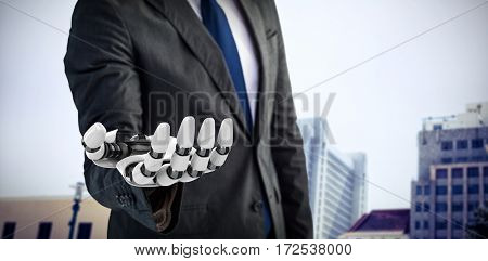 Computer graphic image of businessman with robotic hand against view of apartment with blue sky 3d