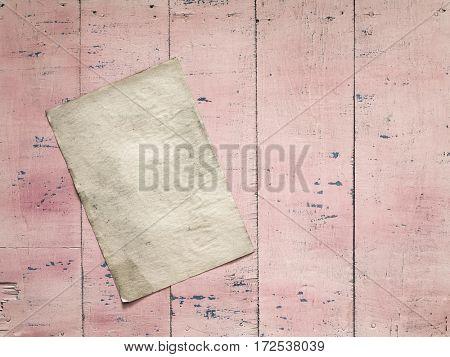 old paper on grunge pink wooden background