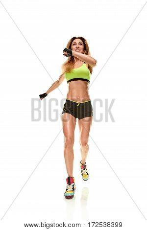 Full-length photo of running woman on white background