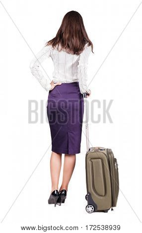Back view of stylishly dressed brunette business woman with suitcase looking up. Standing young girl. Rear view people collection.  backside view of person.  Isolated over white background.
