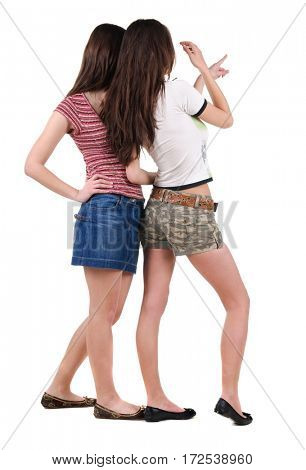 Two young women rear view. Isolated over white.