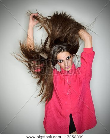Young Brunette Lady Dressed In Pink Blouse Playing With Long Hairs, Ring Flash Studio Portrait On Wh