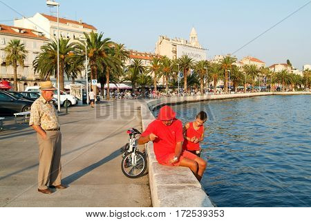 People Walking In Front Of The Sea Front At Split