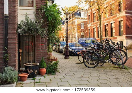 AMSTERDAM/ THE NETHERLANDS - OCTOBER 25, 2015: Picturesque quiet residential street Vondelstraat near the city park Vondelpark in Amsterdam, The Netherlands.