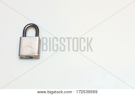 Old and weathered lock against a white background