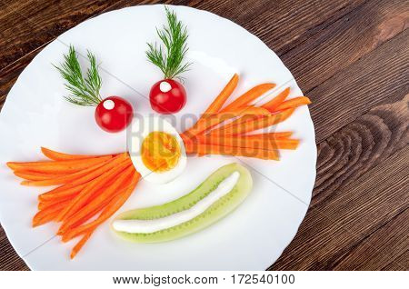 Happy face for kids. Healthy food with vegetables egg and herbs. Funny breakfast or lunch. Top view