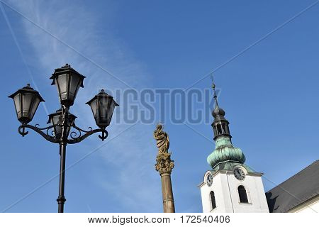 Marian Plague Column and church in Svitavy decorative street lamp