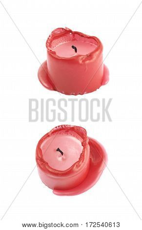 Single burned to the end red candle isolated over the white background, set of two different foreshortenings