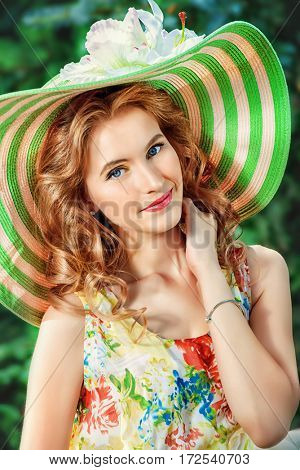 Beautiful romantic girl walking in the park on a sunny summer day. Smiling young woman outdoor. Holiday, vacation.