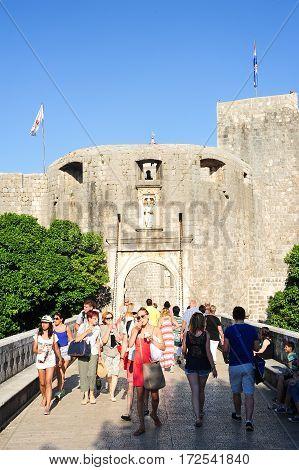 Tourists Entering From The Main Door The Citadel Of Dubrovnik In Croatia