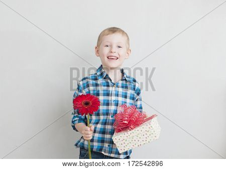 Little Boy With Red Flower And Gift