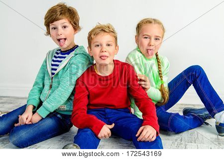 Happy joyful children having fun together. Children's fashion. Education. Happiness, activity and child concept.