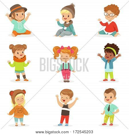 Young Children Dressed In Cute Kids Fashion Clothes, Set Of Illustrations With Kids And Style. Small Boys And Girls Stylishly Dressed Set Of Adorable Cartoon Characters.